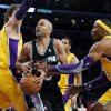 San Antonio Spurs\' Tony Parker, center, of France, is defended by Los Angeles Lakers\' Dwight Howard, right, and Pau Gasol, of Spain, in the first half of an NBA basketball game in Los Angeles, Tuesday, Nov. 13, 2012. (AP Photo/Jae C. Hong)