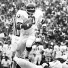 University of Oklahoma running back Billy Sims prepares to hurdle teammate Elvis Peacock (4) during early game action against the Ohio State Buckeyes in Columbus, OH. The Sooners downed the Buckeyes, 29-28, on a last-play, 41-yard field goal. Staff photo by Jim Argo taken 9/24/77; photo ran in the 9/25/77 Daily Oklahoman. File: College Football/OU/OU-Ohio State/Billy Sims/1977