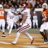 Oklahoma\'s Trey Millard (33) scores in front of Oklahoma State\'s Orie Lemon (41) during the Bedlam college football game between the University of Oklahoma Sooners (OU) and the Oklahoma State University Cowboys (OSU) at Boone Pickens Stadium in Stillwater, Okla., Saturday, Nov. 27, 2010. Photo by Bryan Terry, The Oklahoman