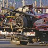 Photo - The GAINSCO Corvette DP is hauled away on a wrecker after driver Memo Gidley was involved in a crash during the IMSA Series Rolex 24 hour auto race at Daytona International Speedway in Daytona Beach, Fla., Saturday, Jan. 25, 2014. (AP Photo/John Raoux)