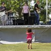 Maaliyah Nelson, 3, of Midwest City places her fingers in her ears while standing in front of the outdoor entertainment stage where the band Jumpshots was performing for the crowd at the Made in Oklahoma Festival held inside and on the grounds of the Reed Conference Center at the Sheraton Midwest City Hotel Saturday afternoon, May, 19, 2012. Nelson watched and listened to the band\'s music from that spot for about 10 minutes. Photo by Jim Beckel, The Oklahoman