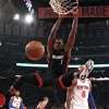 Photo - Miami Heat's Chris Bosh (1) dunks the ball ahead of New York Knicks' Tyson Chandler (6) during the first half of an NBA basketball game Saturday, Feb. 1, 2014, in New York. (AP Photo/Jason DeCrow)