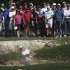 Rory McIlroy, of Northern Ireland, hits from a sand bunker as the gallery watches on the 14th hole during the second round of the Texas Open golf tournament, Friday, April 5, 2013, in San Antonio. (AP Photo/Eric Gay)