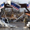 People check out the damage at a Marathon gas station in Henryville, Ind., after powerful storms stretching from the U.S. Gulf Coast to the Great Lakes in the north wrecked two small towns and killed at least eight people Friday, March 2, 2012, as the system tore roofs off schools and homes and damaged a maximum security prison. It was the second deadly tornado outbreak this week. (AP Photo/The News and Tribune, C.E. Branham) ORG XMIT: INJEF101