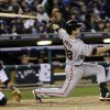 San Francisco Giants\' Buster Posey hits a home run during the sixth inning of Game 4 of baseball\'s World Series against the Detroit Tigers Sunday, Oct. 28, 2012, in Detroit. (AP Photo/David J. Phillip)