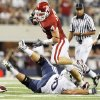 OU's Ryan Reynolds, top, is tripped up on an interception return by BYU's Matt Reynolds in the first quarter Saturday. Photo by Nate Billings, The Oklahoman