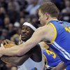 Photo - Denver Nuggets guard Ty Lawson, left, is defended by Golden State Warriors forward David Lee, right, in the second half of an NBA basketball game on Sunday, Jan. 13, 2013, in Denver. The Nuggets won 116-105. (AP Photo/Chris Schneider)