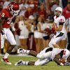 Oklahoma\'s Gabe Lynn (9) hits Ball State\'s Jahwan Edwards (38) during the college football game between the University of Oklahoma Sooners (OU) and the Ball State Cardinals at Gaylord Family-Memorial Stadium on Saturday, Oct. 01, 2011, in Norman, Okla. Oklahoma won 62-6. Photo by Bryan Terry, The Oklahoman