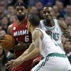 Boston Celtics\' Jeff Green, right, and Courtney Lee, front, double-team Miami Heat\'s LeBron James (6) in the first quarter of an NBA basketball game in Boston, Monday, March 18, 2013. (AP Photo/Michael Dwyer)