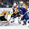 Photo - Tampa Bay Lightning right wing Ryan Callahan (24) attempts to stuff the puck past Philadelphia Flyers goalie Ray Emery (29) as center Sean Couturier (14) and right wing Matt Read (24) defend during the second period of an NHL hockey game Thursday, April 10, 2014, in Tampa, Fla. (AP Photo/Chris O'Meara)