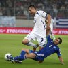 Photo -   Greece's Nikos Spyropoulos, right, tries to stop Bosnia-Herzegovina's Vedad Ibisevic during their World Cup Group G qualifying soccer match at the Karaiskaki stadium in Piraeus port, near Athens, Thursday, Oct. 11, 2012. (AP Photo/Thanassis Stavrakis)