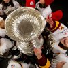 Eight-year-old Rachel Hopkins, right, shows her excitement as the Vancouver Angels novice C1 minor hockey team gather around the Stanley Cup after they were surprised with it before their youth hockey practice Friday, Dec. 7, 2012, in Vancouver, British Columbia. Five minor hockey teams in Canada were randomly chosen to receive a surprise appearance by the Stanley Cup as part of the Scotiabank Community Hockey Sponsorship Program. The NHL lockout is in its 82nd day. (AP Photo/The Canadian Press, Darryl Dyck)