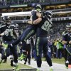 Photo - Seattle Seahawks running back Marshawn Lynch (24) celebrates with tight end Zach Miller (86) after running for a 31-yard touchdown against the New Orleans Saints during the fourth quarter of an NFC divisional playoff NFL football game in Seattle, Saturday, Jan. 11, 2014. (AP Photo/John Froschauer)