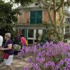 Photo - In this May 26 photo, a replica of the facade of French impressionist artist Claude Monet's pink stucco house is featured in an exhibition at the New York Botanical Garden in New York.