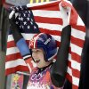Photo - Erin Hamlin of the United States waves the flag after finishing her final run to win the bronze medalduring the women's singles luge competition at the 2014 Winter Olympics, Tuesday, Feb. 11, 2014, in Krasnaya Polyana, Russia. (AP Photo/Natacha Pisarenko)