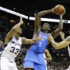 Oklahoma City\'s Kendrick Perkins (5) goes to the basket beside San Antonio\'s Boris Diaw during Game 1 of the Western Conference Finals between the Oklahoma City Thunder and the San Antonio Spurs in the NBA playoffs at the AT&T Center in San Antonio, Texas, Sunday, May 27, 2012. Photo by Bryan Terry, The Oklahoman