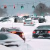Snowbound vehicles remain stranded Saturday morning, Feb. 9, 2013 along Route 347 in Lake Grove, N.Y. Hundreds of cars were stranded on New York's Long Island roadways as snow rapidly covered roadways. Many people abandoned their vehicles and first responders rescued motorists who chose to spend the frigid night in their vehicles. (AP Photo/Newsday, John Paraskevas)