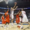 Oklahoma\'s Blake Griffin (23) puts up a reverse layup over the Syracuse defense during the first half of the NCAA Men\'s Basketball Regional at the FedEx Forum on Friday, March 27, 2009, in Memphis, Tenn. PHOTO BY CHRIS LANDSBERGER, THE OKLAHOMAN