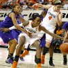 Oklahoma State\'s Toni Young (15) goes for the ball beside Stephen F. Austin\'s Tierany Henderson (31) as Oklahoma State\'s Liz Donohoe (4) watches during a women\'s college basketball game between Oklahoma State University and Stephen F. Austin at Gallagher-Iba Arena in Stillwater, Okla., Thursday, Dec. 6, 2012. Photo by Bryan Terry, The Oklahoman