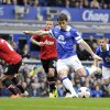 Photo - Everton's Leighton Baines scores the first goal of the game for his side from the penalty spot during their English Premier League soccer match against Manchester United at Goodison Park in Liverpool, England, Sunday April 20, 2014. (AP Photo/Clint Hughes)