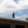 Darrell John stands on the roof of a building at a construction site in Oklahoma CIty, Thursday, June 5, 2007. BY DEVONA WALKER, THE OKLAHOMA