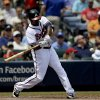Atlanta Braves\' Justin Upton swings to hit a single in the fourth inning of a baseball game against the Kansas City Royals, Wednesday, April 17, 2013, in Atlanta. (AP Photo/David Goldman)