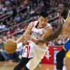 Houston Rockets\' Jeremy Lin drives against Golden State Warriors\' Draymond Green, right, during the fourth quarter of an NBA basketball game, Tuesday, Feb. 5, 2013, in Houston. The Rockets beat the Warriors 140-109. (AP Photo/Dave Einsel)