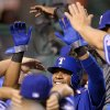 Photo -   Texas Rangers' Elvis Andrus is congratulated by teammates after scoring on a double by Michael Young during the third inning of their baseball game against the Los Angeles Angels, Wednesday, Sept. 19, 2012, in Anaheim, Calif. (AP Photo/Mark J. Terrill)