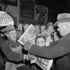 FILE - In this Dec. 7, 1941 file photo, people buy newspapers reporting the Japanese attack on U.S. bases in the Pacific Ocean, at Times Square in New York. (AP Photo/Robert Kradin)