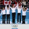 Canada\'s women\'s curling team as seen from left to right, Kirsten Wall, Dawn McEwen, Jill Officer, Kaitlyn Lawes and skip Jennifer Jones, celebrate during the flower ceremony after winning the women\'s curling gold medal game against Sweden at the 2014 Winter Olympics, Thursday, Feb. 20, 2014, in Sochi, Russia. (AP Photo/Wong Maye-E)