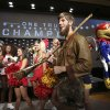Michael Garcia, dressed as West Virginia\'s mountaineer mascot, caries a musket after posing for a photo with cheerleaders and mascots at the Big 12 Conference NCAA college football media days in Dallas, Tuesday, July 22, 2014. (AP Photo)