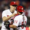 Photo - Philadelphia Phillies' closer Jonathan Papelbon, left, and catcher Carlos Ruiz celebrate at the end of a baseball game against the Miami Marlins, Friday, April 11, 2014, in Philadelphia. The Phillies won 6-3. (AP Photo/Tom Mihalek)