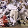 Photo - Kansas City, Mo. Saturday,12/06/2003 . BIG 12 CHAMPIONSHIP UNIVERSITY OF OKLAHOMA  (OU) VS KANSAS STATE (KSU) COLLEGE FOOTBALL AT ARROWHEAD STADIUM. The Wildcat defense is all over Sooners Renaldo Works on a short run in the 2nd quarter. (Staff photo by Steve Gooch)