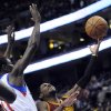 Photo -   Philadelphia 76ers' Jrue Holiday (11) fouls Cleveland Cavaliers' Kyrie Irving (2) during the first half of an NBA basketball game on Sunday, Nov. 18, 2012, in Philadelphia. (AP Photo/Michael Perez)