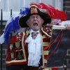 Tony Appleton, a town crier, announces the birth of the royal baby, outside St. Mary\'s Hospital exclusive Lindo Wing in London, Monday, July 22, 2013. Palace officials say Prince William\'s wife Kate has given birth to a baby boy. The baby was born at 4:24 p.m. and weighs 8 pounds 6 ounces. The infant will become third in line for the British throne after Prince Charles and William. (AP Photo/Lefteris Pitarakis)