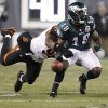 Cincinnati Bengals\' Carlos Dunlap, left, knocks the ball out of the hands of Philadelphia Eagles\' Jeremy Maclin, right, during the first quarter of an NFL football game at Lincoln Financial Field in Philadelphia on Dec. 13, 2012. (AP Photo/Philadelphia Daily News, David Maialetti)
