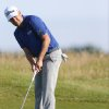 Photo - Erik Compton of the US putt on the 6th green during the first day of the British Open Golf championship at the Royal Liverpool golf club, Hoylake, England, Thursday July 17, 2014. (AP Photo/Peter Morrison)
