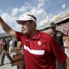 Oklahoma\'s Bob Stoops celebrates after the Red River Rivalry college football game between the University of Oklahoma Sooners (OU) and the University of Texas Longhorns (UT) at the Cotton Bowl in Dallas, Saturday, Oct. 8, 2011. Oklahoma won 55-17. Photo by Bryan Terry, The Oklahoman