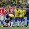 Photo - Referee Yuichi Nishimura from Japan gives Brazil's Neymar (10) a yellow card during the group A World Cup soccer match between Brazil and Croatia, the opening game of the tournament, in the Itaquerao Stadium in Sao Paulo, Brazil, Thursday, June 12, 2014.  (AP Photo/Felipe Dana)