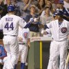 Photo - Chicago Cubs' Anthony Rizzo (44) celebrates his home run off Cincinnati Reds starting pitcher Homer Bailey, with Starlin Castro, right, during the fourth inning of a baseball game Tuesday, June 24, 2014, in Chicago. (AP Photo/Charles Rex Arbogast)