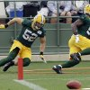 Green Bay Packers\' Nate Palmer and teammate Clay Matthews run a drill during NFL football training camp Saturday, July 27, 2013, in Green Bay, Wis. (AP Photo/Morry Gash)