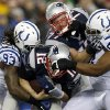 New England Patriots quarterback Tom Brady (12) is sacked by Indianapolis Colts linebacker Erik Walden (93) and defensive tackle Jeris Pendleton (61) during the first half of an AFC divisional NFL playoff football game in Foxborough, Mass., Saturday, Jan. 11, 2014. (AP Photo/Michael Dwyer)