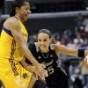 FILE - In this Sept. 6, 2011 file photo, San Antonio Silver Stars guard Becky Hammon, right, drives on Los Angeles Sparks forward Candace Parker, left, as she moves to the basket in the first half of a WNBA basketball game in Los Angeles. Stars guard and 16-year WNBA veteran Becky Hammon will retire at the conclusion of the 2014 WNBA season, the team announced Wednesday, July 23, 2014. (AP Photo/Gus Ruelas, File)