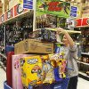 Shopper Shelly Church balances her cart at Toys R Us in Oklahoma City on Black Friday in 2011. Photo by Steve Gooch, The Oklahoman