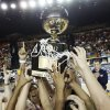 The Shawnee Lady Wolves celebrate with the gold ball championship trophy after the Class 5A girls high school basketball state tournament championship game between Shawnee and East Central at the Mabee Center in Tulsa, Okla., Saturday, March 10, 2012. Shawnee won, 45-41. Photo by Nate Billings, The Oklahoman
