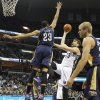Photo - Memphis Grizzlies center Marc Gasol (33), of Spain, shoots against New Orleans Pelicans forward Anthony Davis (23) in the first half of an NBA basketball game, Monday, Jan. 20, 2014, in Memphis, Tenn. (AP Photo/Lance Murphey)