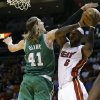 Photo - Miami Heat's LeBron James (6) shoots as Boston Celtics' Kelly Olynyk (41) defends during the first half of an NBA basketball game Saturday, Nov. 9, 2013, in Miami. (AP Photo/Lynne Sladky)