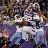 Minnesota Vikings tight end Kyle Rudolph (82) catches a 15-yard touchdown pass between Tennessee Titans\' Jordan Babineaux, left, and Michael Griffin, right, during the second half of an NFL football game on Sunday, Oct. 7, 2012, in Minneapolis. (AP Photo/Genevieve Ross)