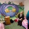 Patricia Rowe, supervisor and trainer at the Pauline A. Mayer Children\'s Shelter in Oklahoma City, sits near a colorful mural of a fairy tale scene that makes the room one of the most popular for young girls. Photo taken during a tour on Monday, Jan. 23, 2012. Photo by Jim Beckel, The Oklahoman