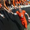Oklahoma State\'s J.W. Walsh (4) celebrates with fans after a college football game between Oklahoma State University (OSU) and Iowa State University (ISU) at Boone Pickens Stadium in Stillwater, Okla., Saturday, Oct. 20, 2012. OSU won, 31-10. Photo by Nate Billings, The Oklahoman